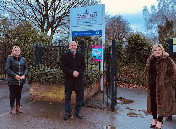 Dorothy Coates, John Healey MP and Cllr Charlotte Johnson outside Carrfield school.
