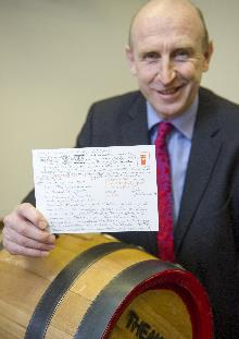 john healey gives a 'message in a barrel' to the chancellor (2)_be