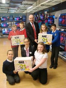 john healey mp presenting equipment to schools as part of the tesco vouchers scheme_be